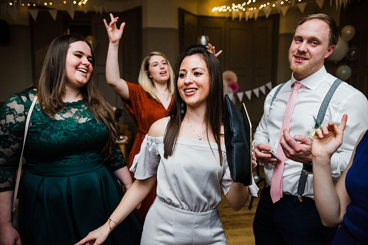 Wedding guests dancing at the wedding reception - Photo taken by Parrot and Pineapple Wedding Photography