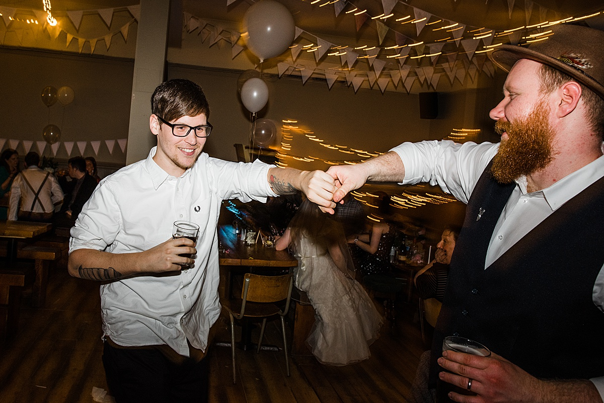 Two male wedding guests dancing - Photo taken by Parrot and Pineapple Wedding Photography
