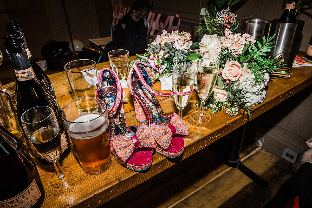 Glittery peep toe wedding shoes on the bar - Photo taken by Parrot and Pineapple Wedding Photography