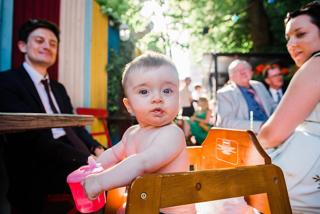 Baby enjoying the pub garden at the wedding reception Gipsy Queen London