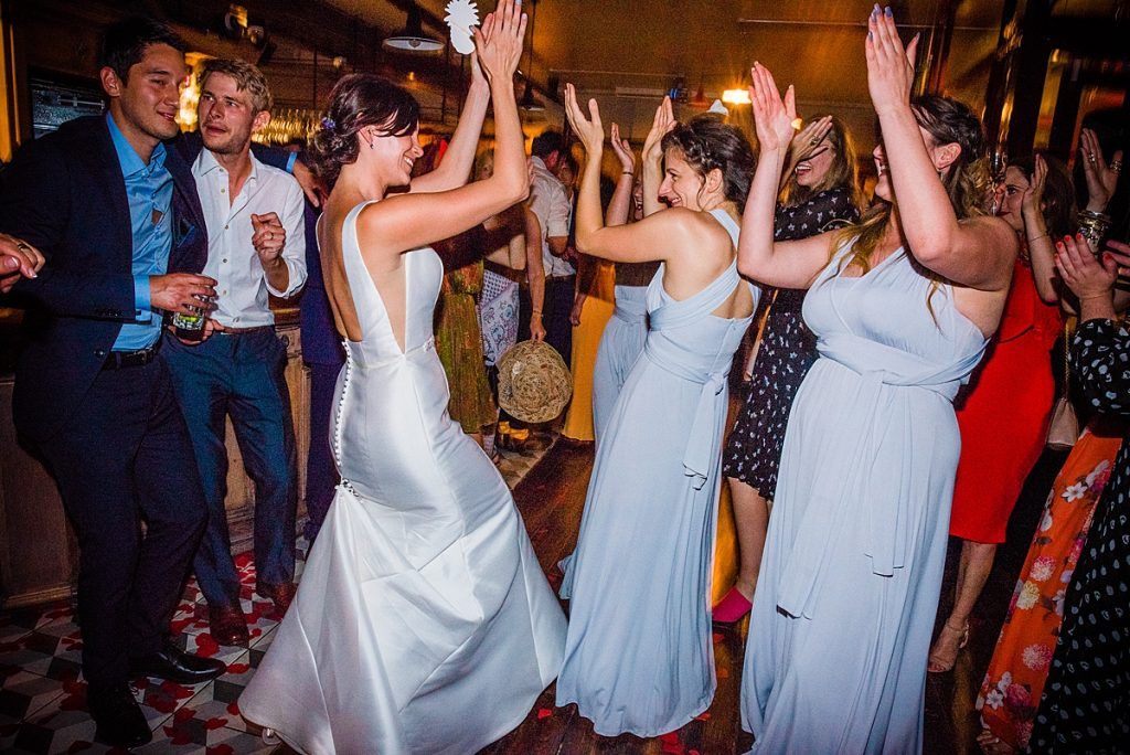 Bride and bridesmaids dancing at the reception