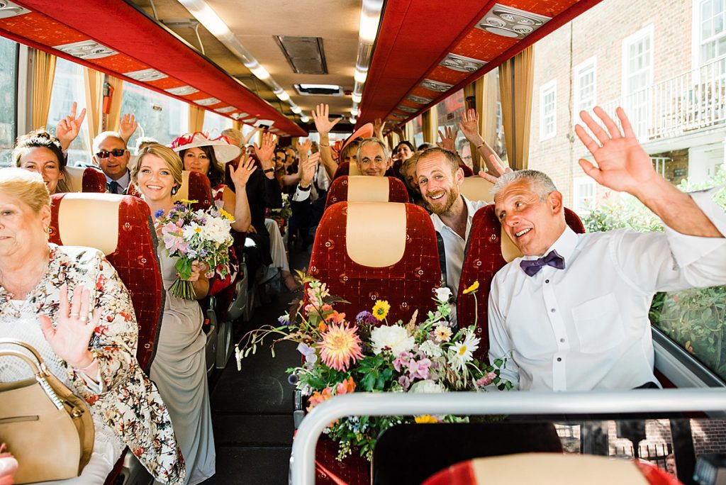 Guests on the way to Gipsy Queen reception in a coach