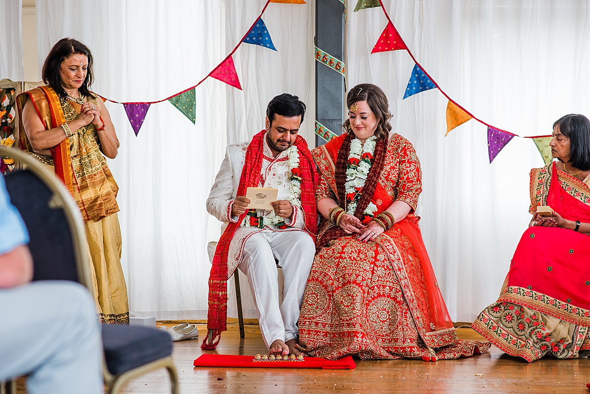 Bride and groom at hindu wedding ceremony taking place at Greenwich Yacht Club. Image by Parrot and Pineapple. Click through to see more brightly coloured wedding photos.