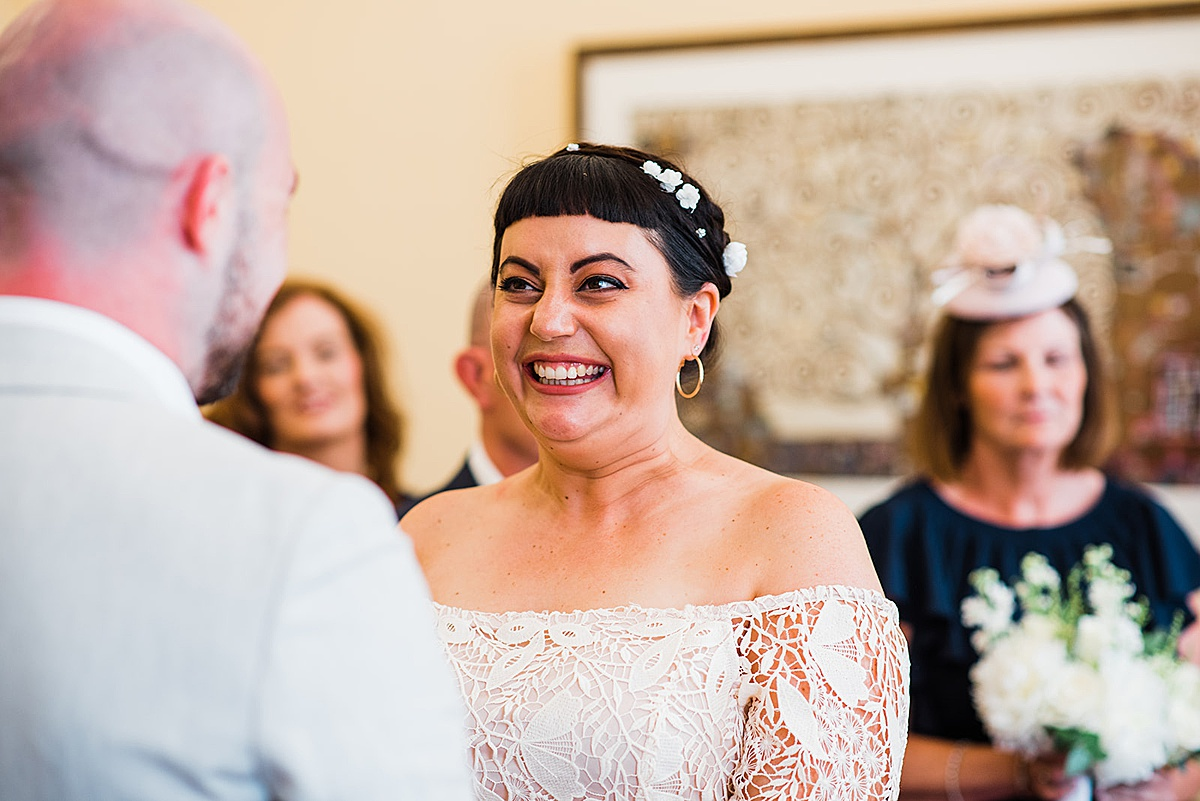 Bride smiles at groom - Islington town hall wedding - Parrot and Pineapple photography