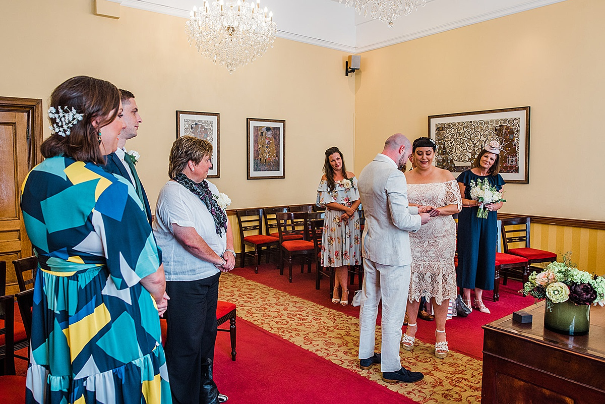 Couple exchange rings during Islington town hall wedding - Parrot and Pineapple photography