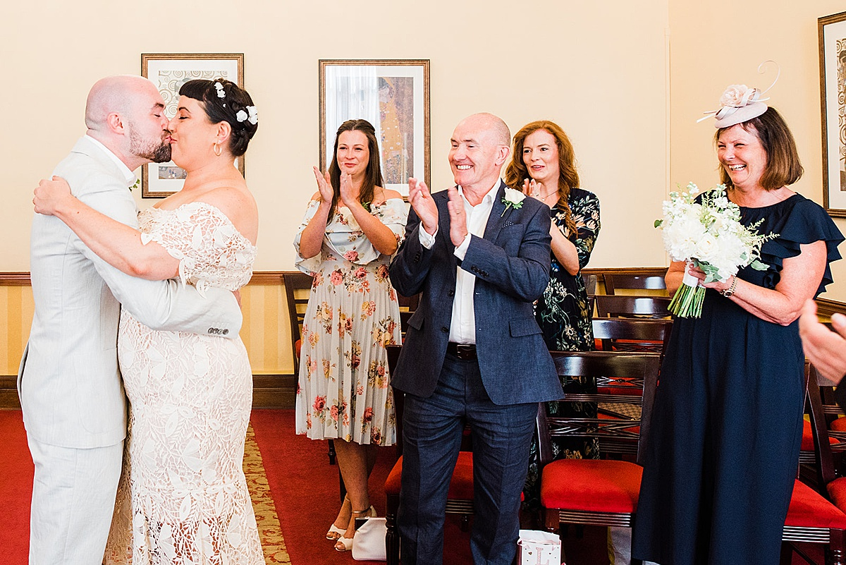 First kiss as a married couple - Islington town hall wedding - Parrot and Pineapple photography