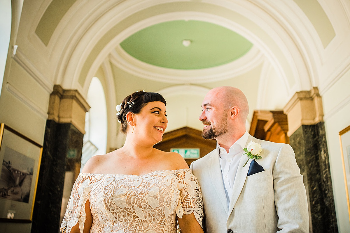 Newly married couple inside - Islington town hall wedding - Parrot and Pineapple photography