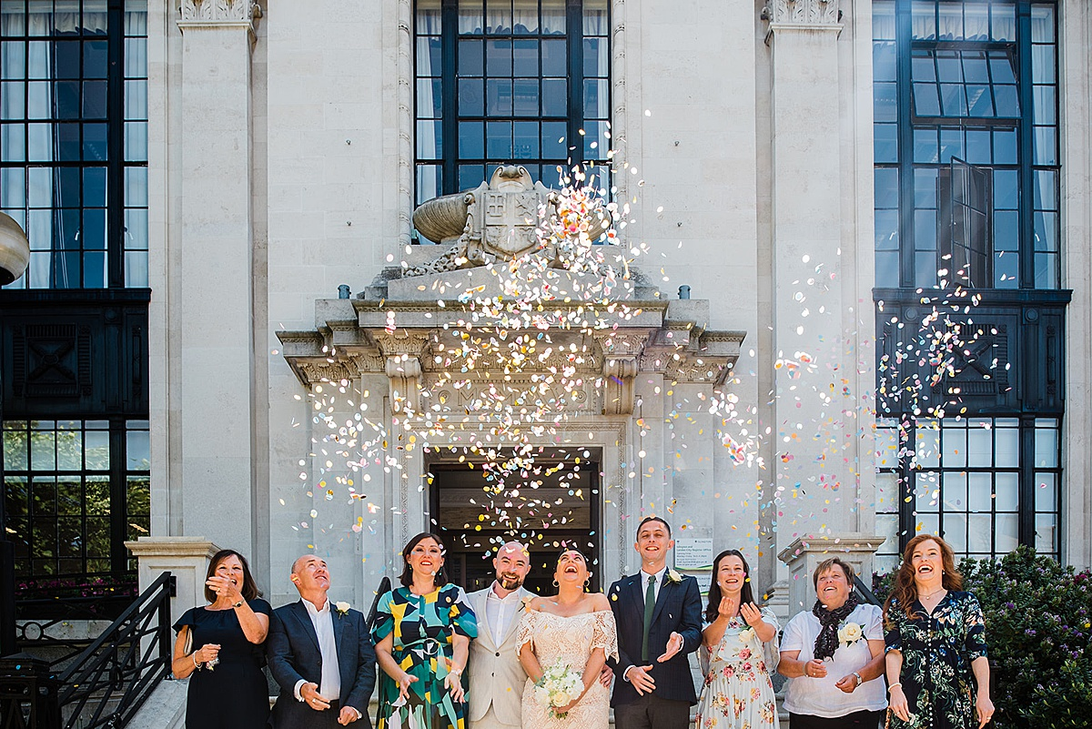 Family group photo with confetti - Islington town hall wedding - Parrot and Pineapple photography