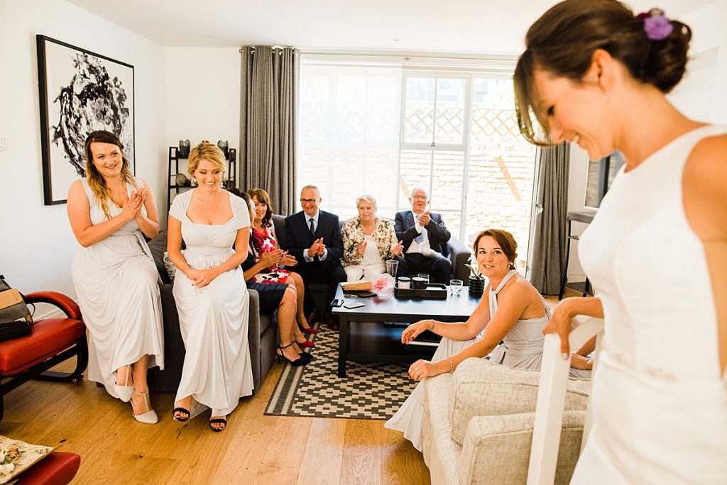 Jade showing her family her dress before the ceremony at Burgh House
