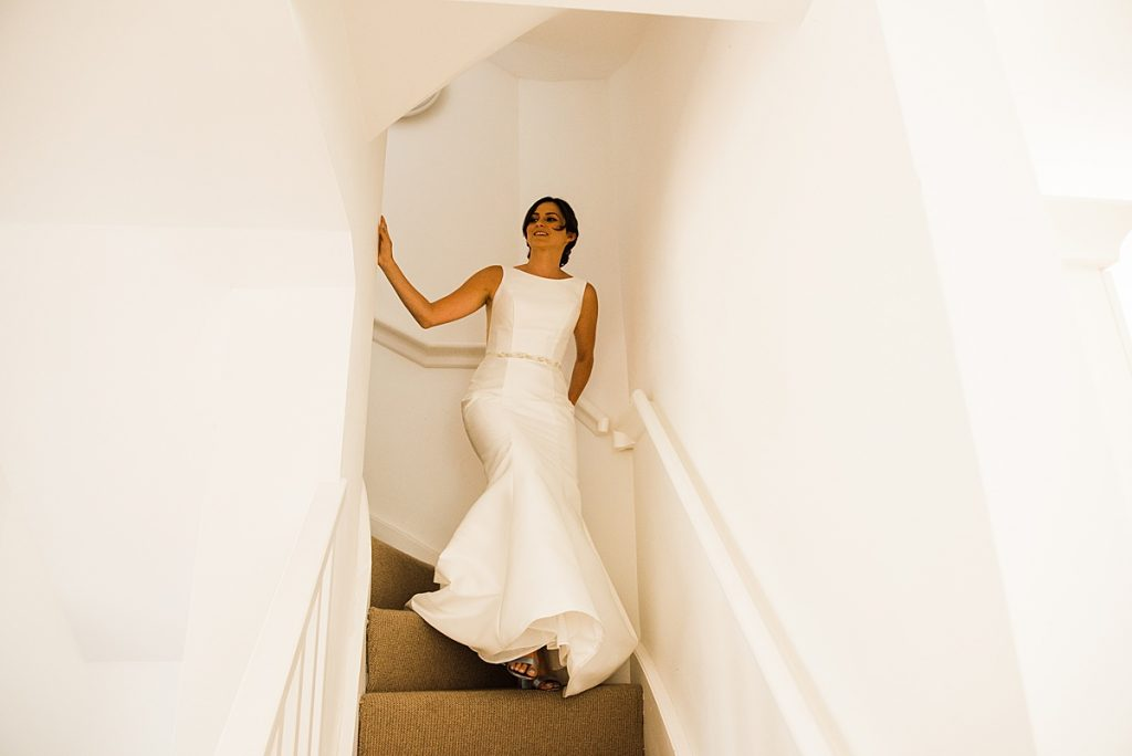 Jade coming down the stairs in her wedding Dress by Maggie Sottero and Midgley