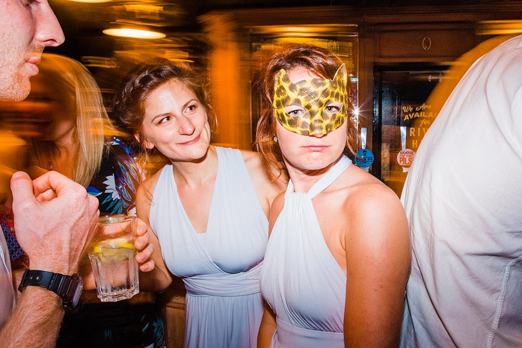 female bridesmaid wearing leopard mask