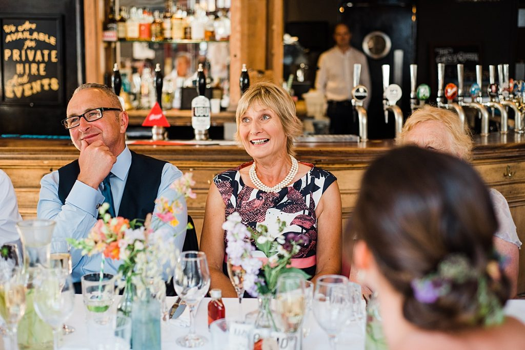 wedding guests enjoying the speeches at the pub