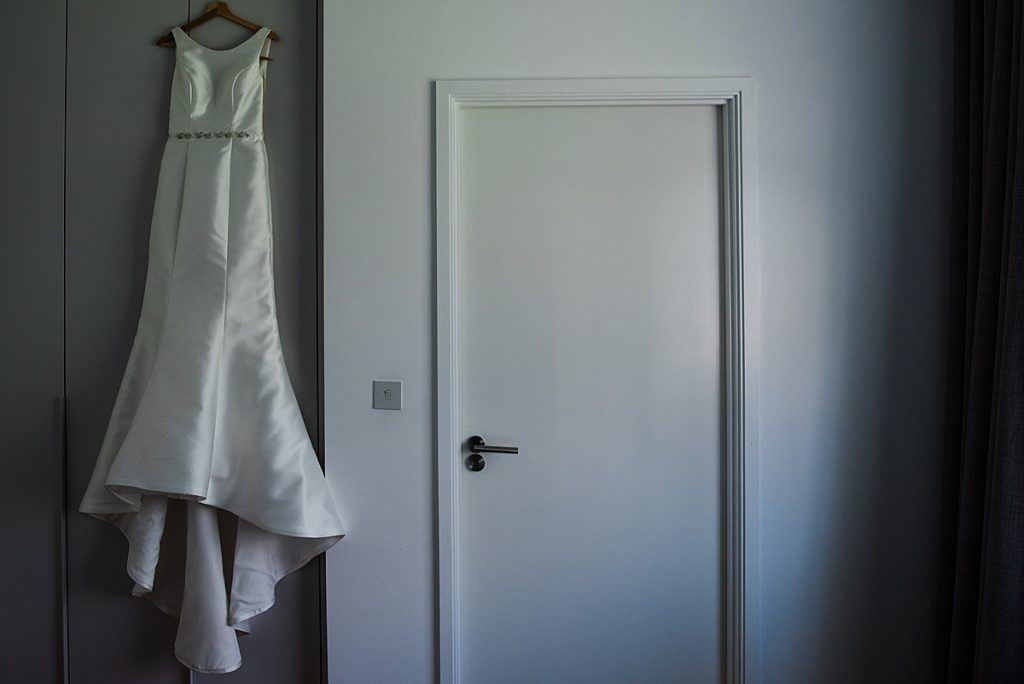 Jade's Wedding Dress hanging up in her bedroom