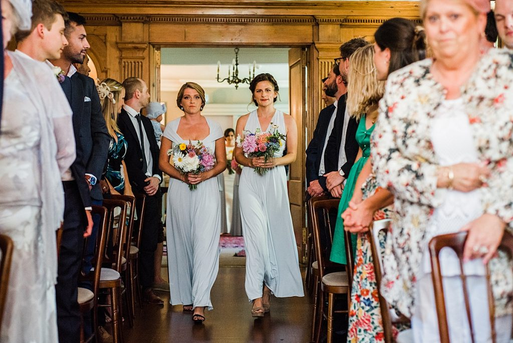Bridesmaids walking down the aisle at Burgh House