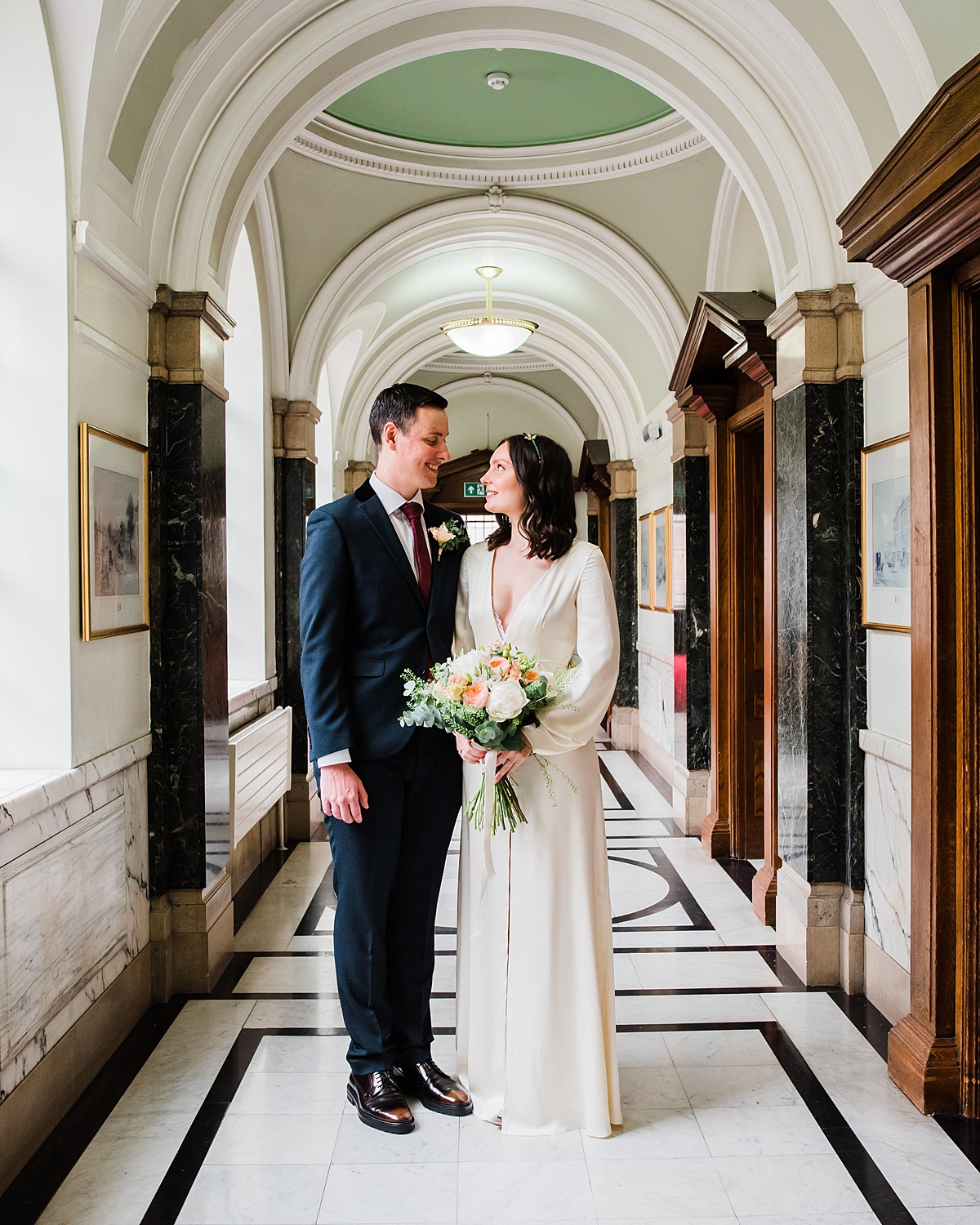 bride and groom at islington town hall elopement  - parrot and pineapple wedding photography