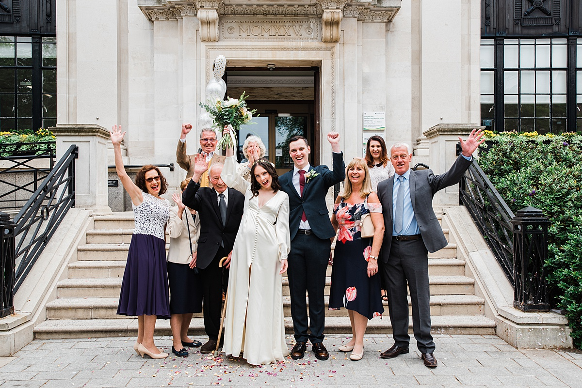 bridal party outside islington town hall  - parrot and pineapple wedding photography