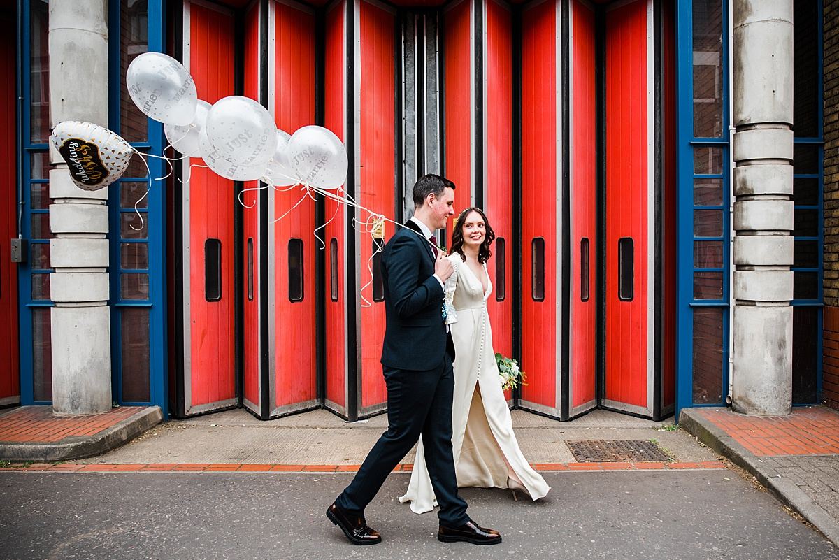 Temperley wedding gown Bride on Upper Street Islington with new husband  - parrot and pineapple wedding photography