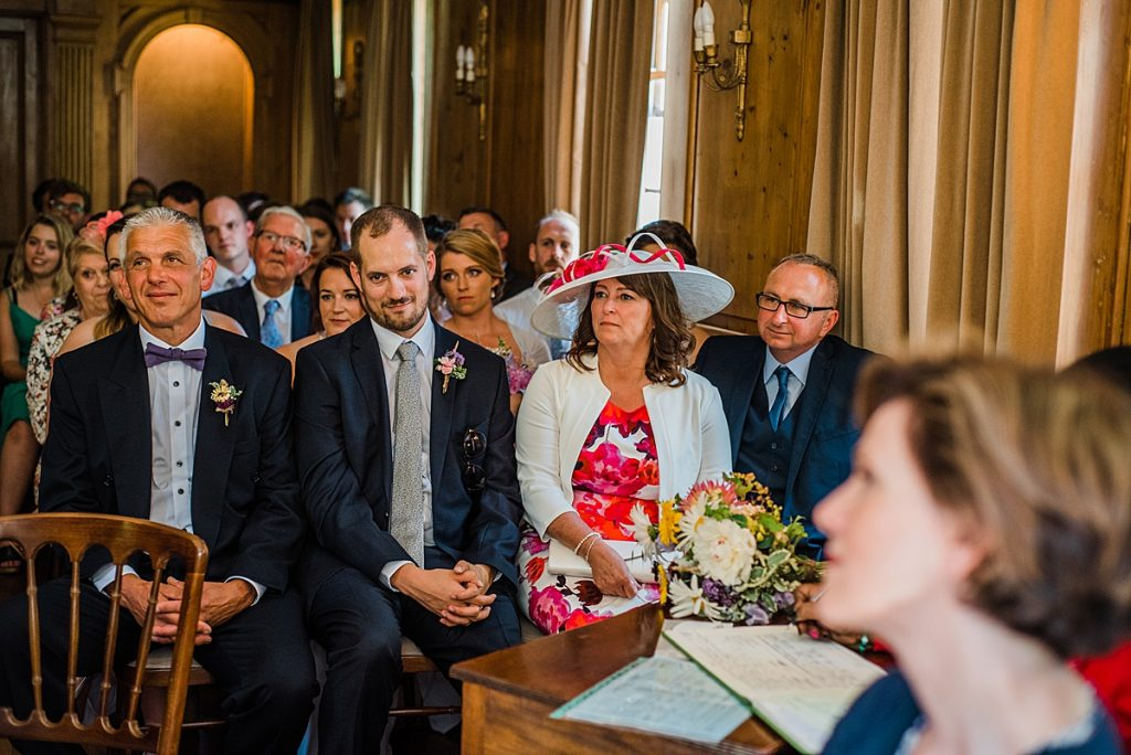 wedding guests listening to the ceremony at Burgh House