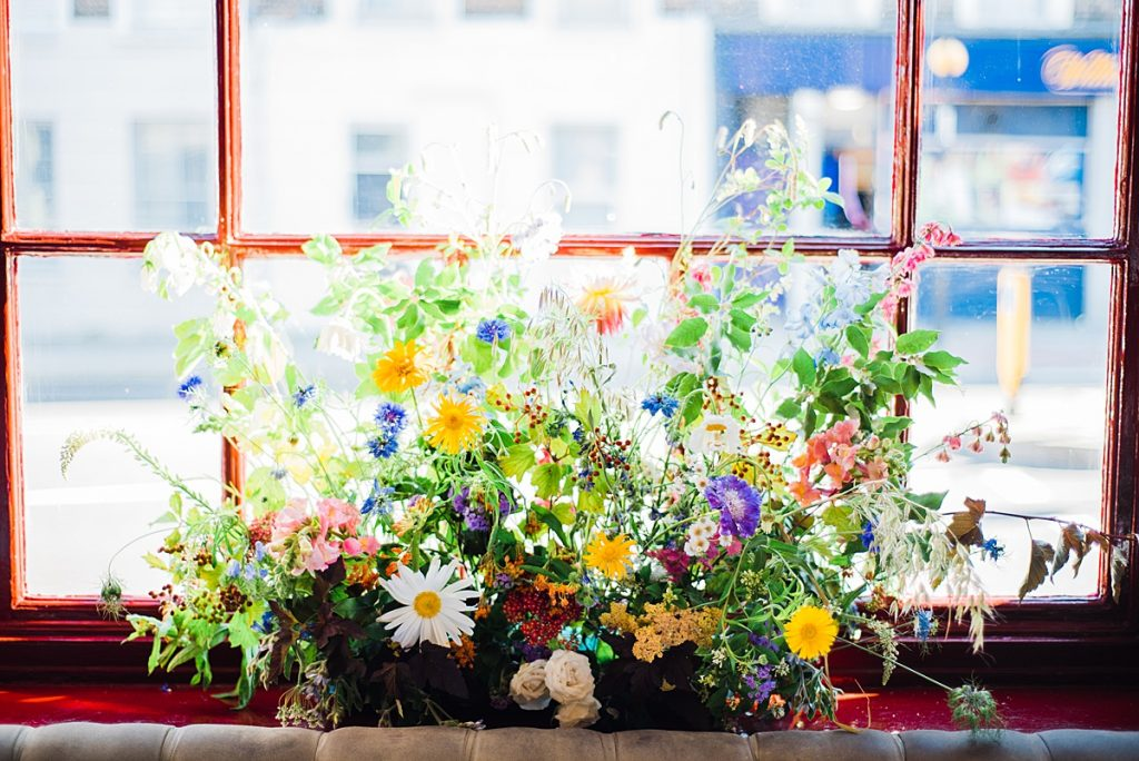 florals in the windows at Gipsy Queen pub