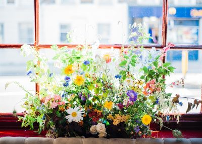 Wedding flowers in the windows at Gipsy Queen pub