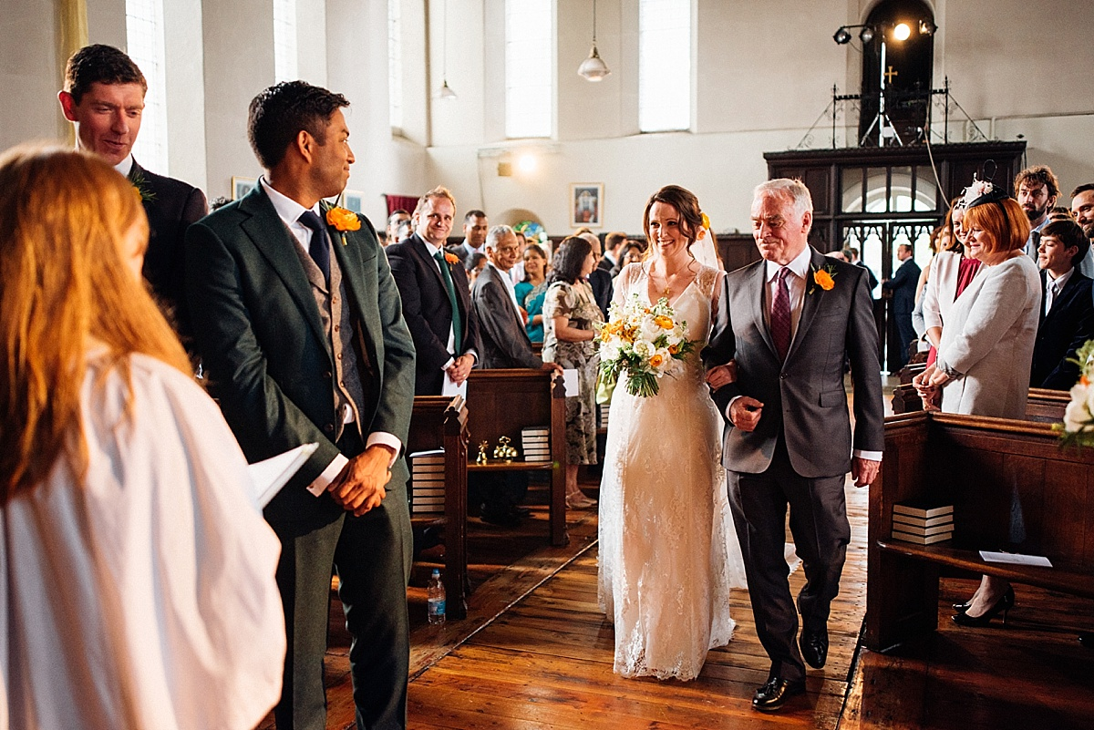 Brides walks down the aisle to her husband for a hackney town hall wedding