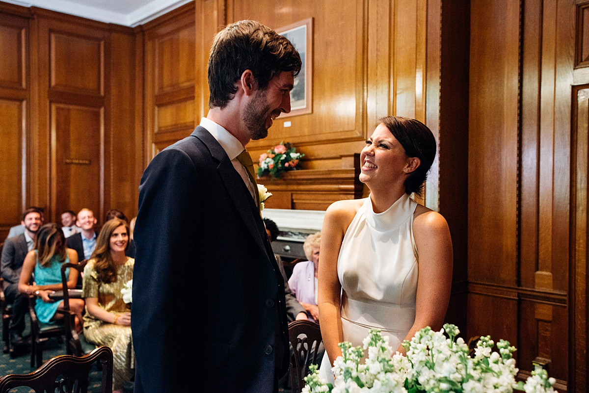 Wedding ceremony at Camden registry office followed by a Shoreditch warehouse wedding reception. Image by Parrot & Pineapple Wedding Photography.