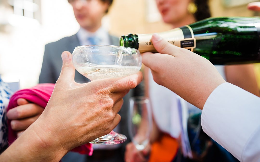 Champagne reception at a London city wedding. Image by Parrot & Pineapple.
