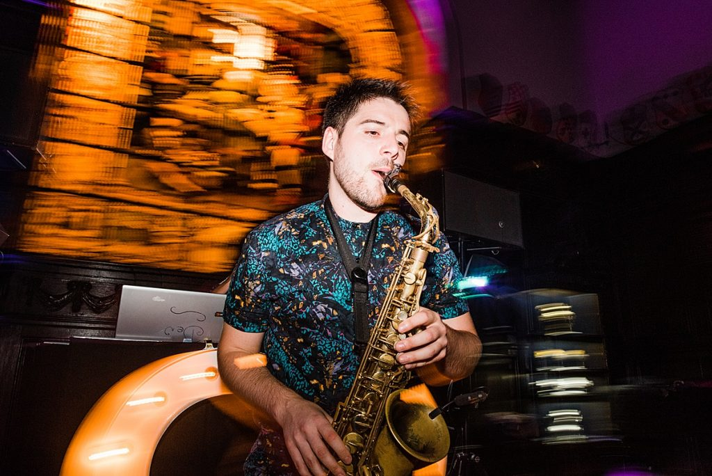 Saxophonist plays alongside a DJ at a London City Wedding. Image by Parrot & Pineapple.