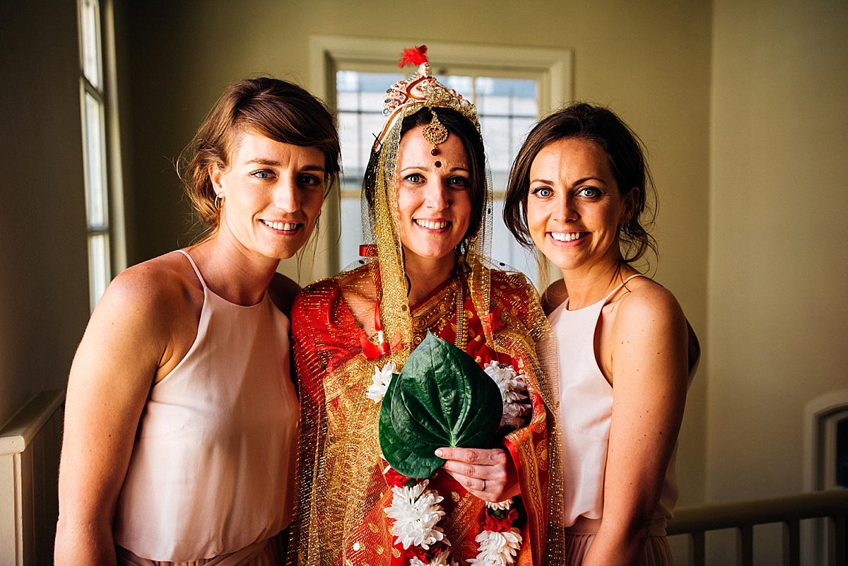 Hindu bride with blush bridesmaids before hackney town hall wedding reception