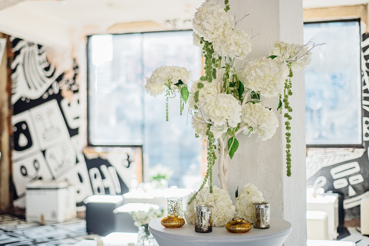 White hydrangea floral arrangement at warehouse wedding. Image by Parrot and Pineapple.