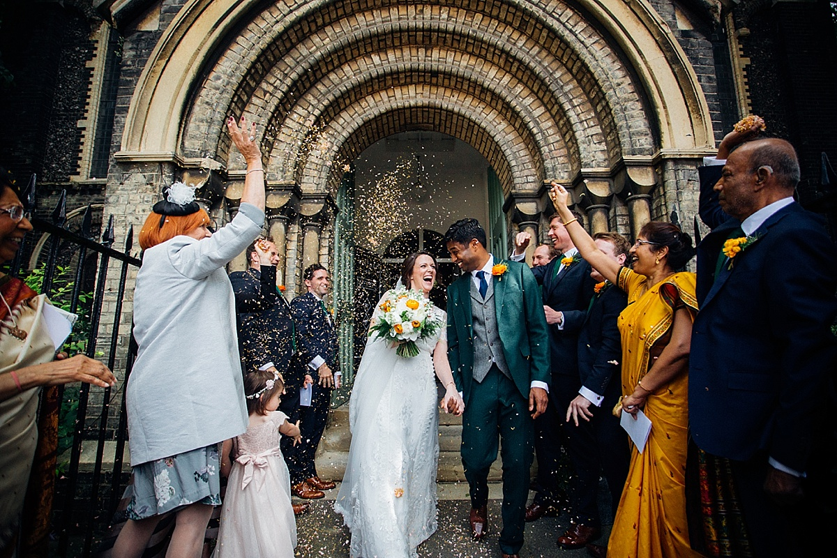 bride and groom showered with confetti for a hackney town hall wedding