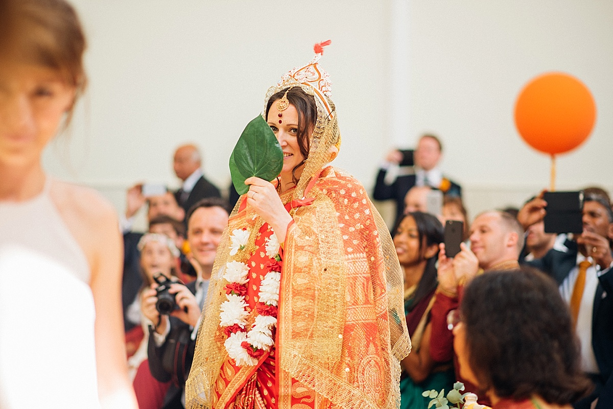 bride enters hindu ceremony before hackney town hall wedding