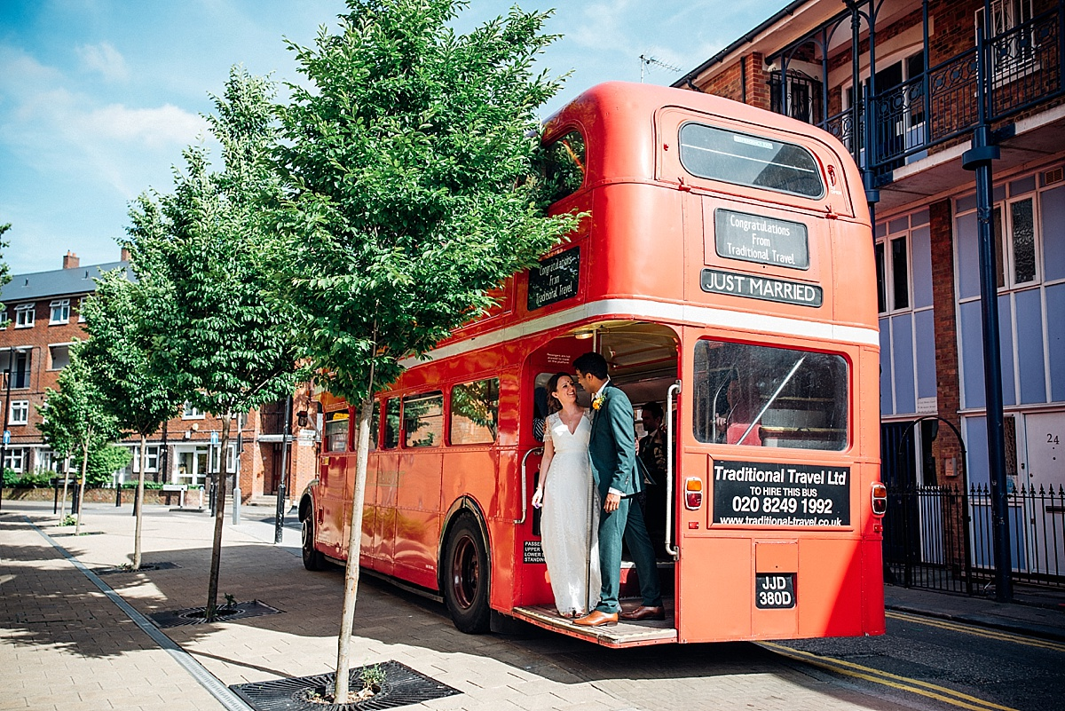 Traditional london red bus for hackney town hall wedding