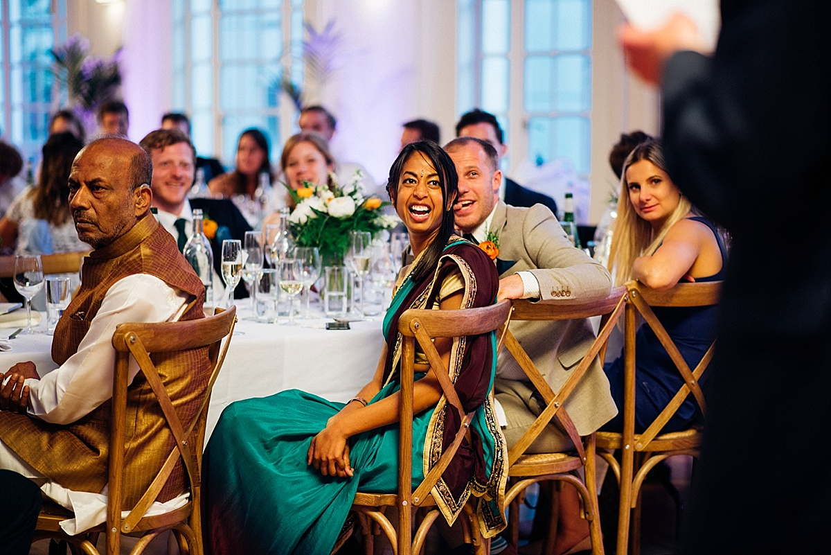 guests laughing during speeches at hackney town hall wedding