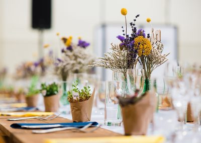 florals and mini plant pots on wedding breakfast table taken by Parrot & Pineapple Wedding Photography