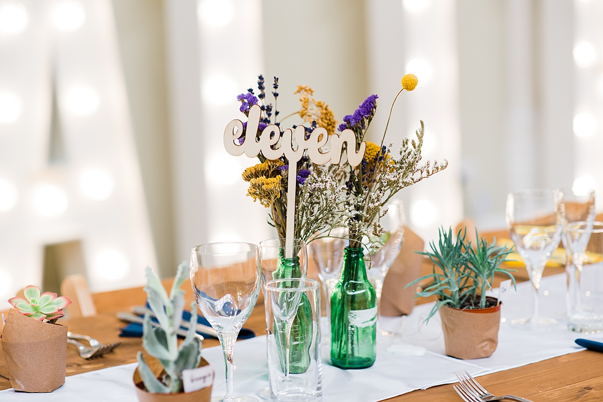 wood cut number eleven on wedding breakfast table taken by Parrot & Pineapple Wedding Photography