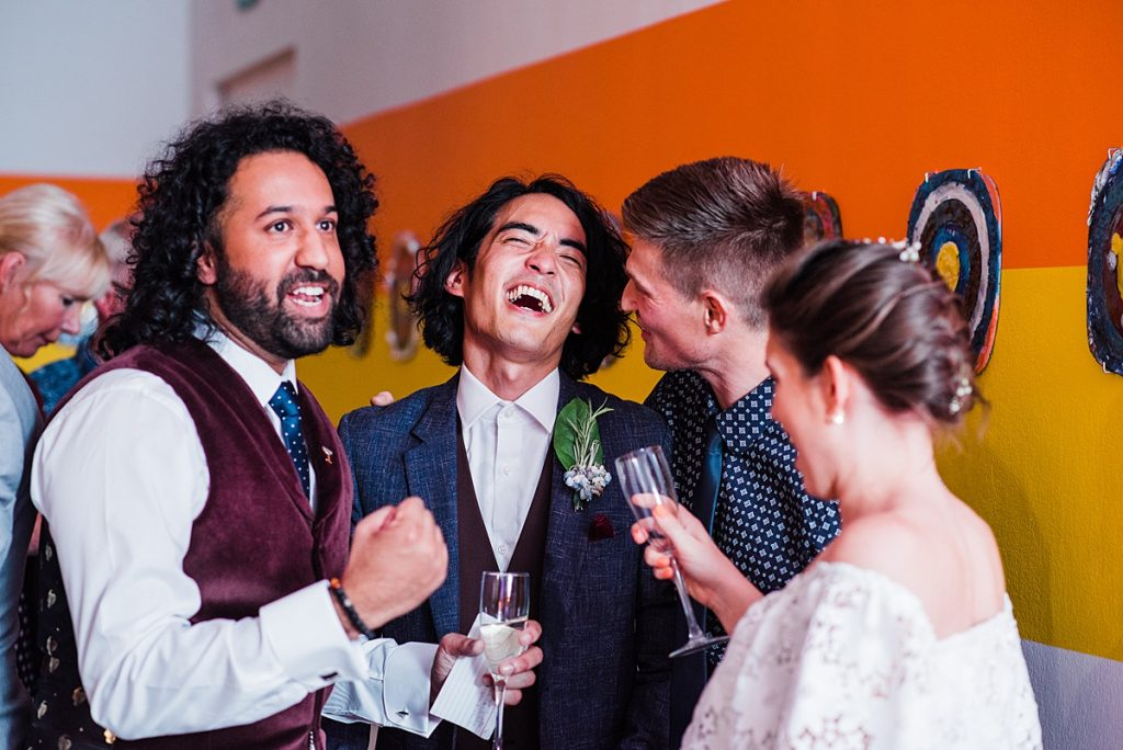 Groom friends laugh. Ikon gallery wedding by Parrot & Pineapple Wedding Photography