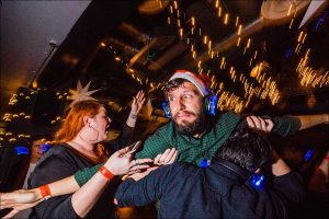 man being carried on the dance floor pulling scared face taken by Parrot & Pineapple Wedding Photography