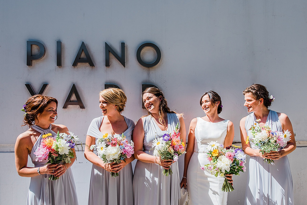 Bride and bridesmaids before the wedding. Image by Parrot and Pineapple Wedding Photography