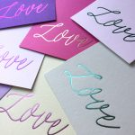 """Wedding Invites with purple cards and italic """"love"""" from Lucky Ink Wedding Stationers"""