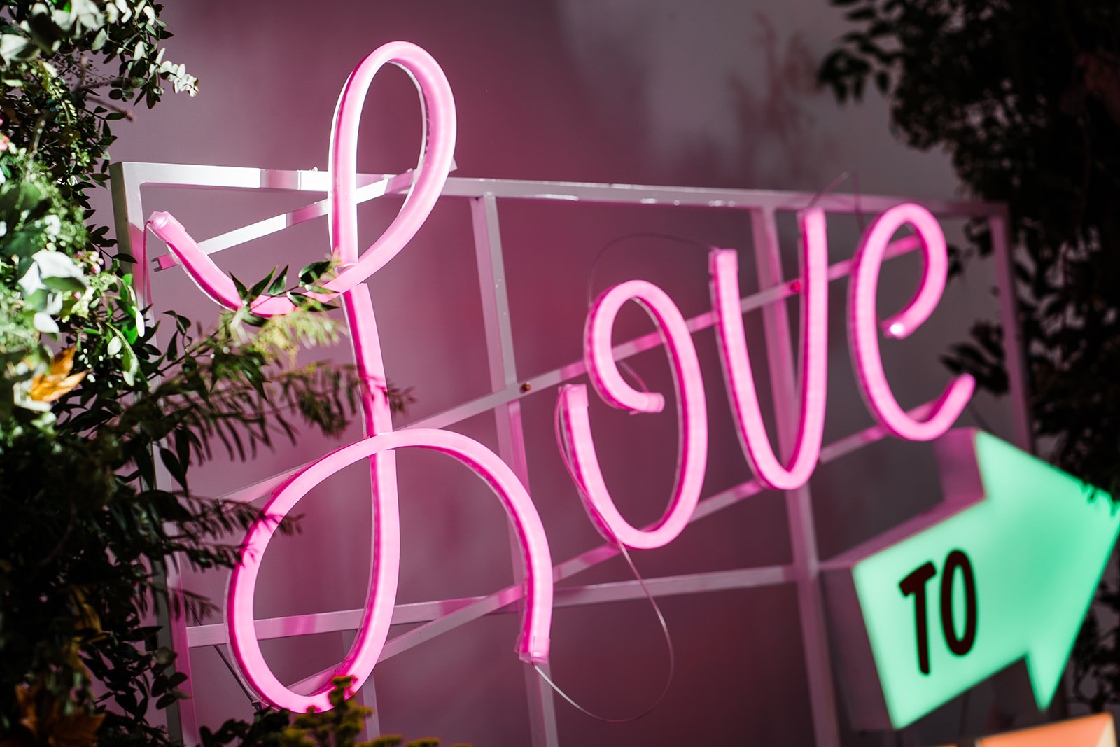 neon love light sign taken by parrot and pineapple wedding photography