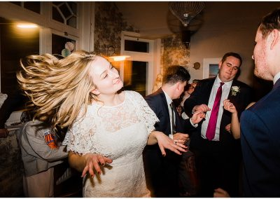 Bride-dancing-urban-pub-wedding-london-Parrot-and-Pineapple-Wedding-Photography