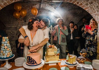 Cake-cutting-at-Brunswick-House-Parrot-and-Pineapple-Wedding-Photography