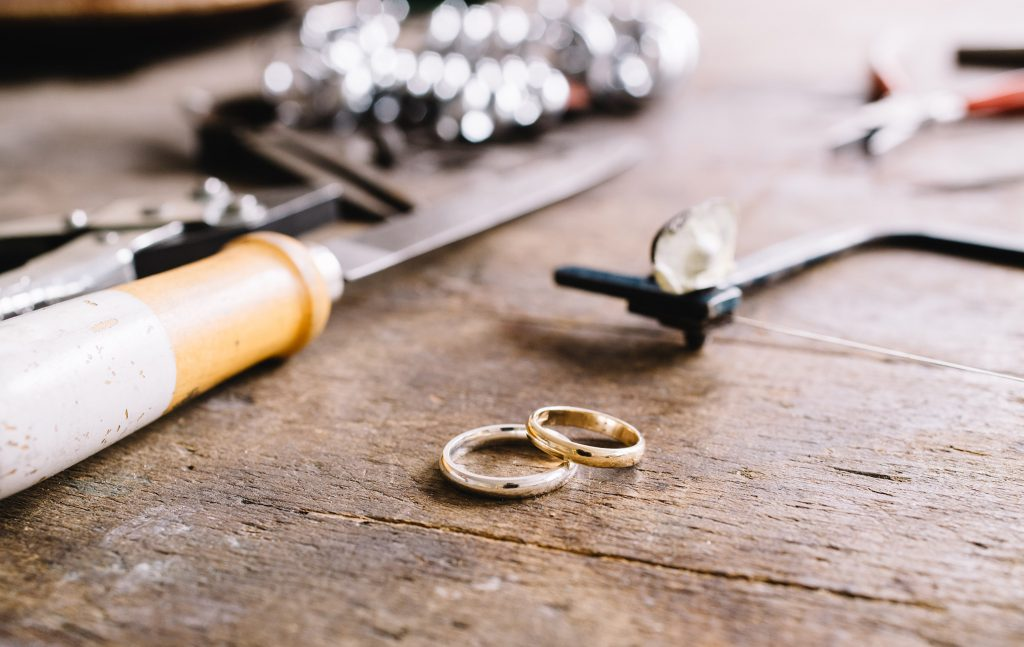 How to select your wedding rings - wedding rings being made on a workbench.