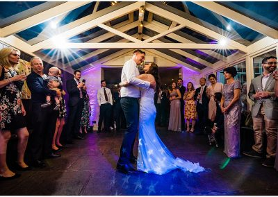 Bride and groom dance surrounded by wedding guests at The Bay Tree Hotel in Burford Oxfordshire