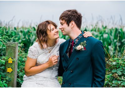 Wedding-Couple-in-field-DIY-Home-Garden-Wedding-Parrot-and-Pineapple-Wedding-Photography