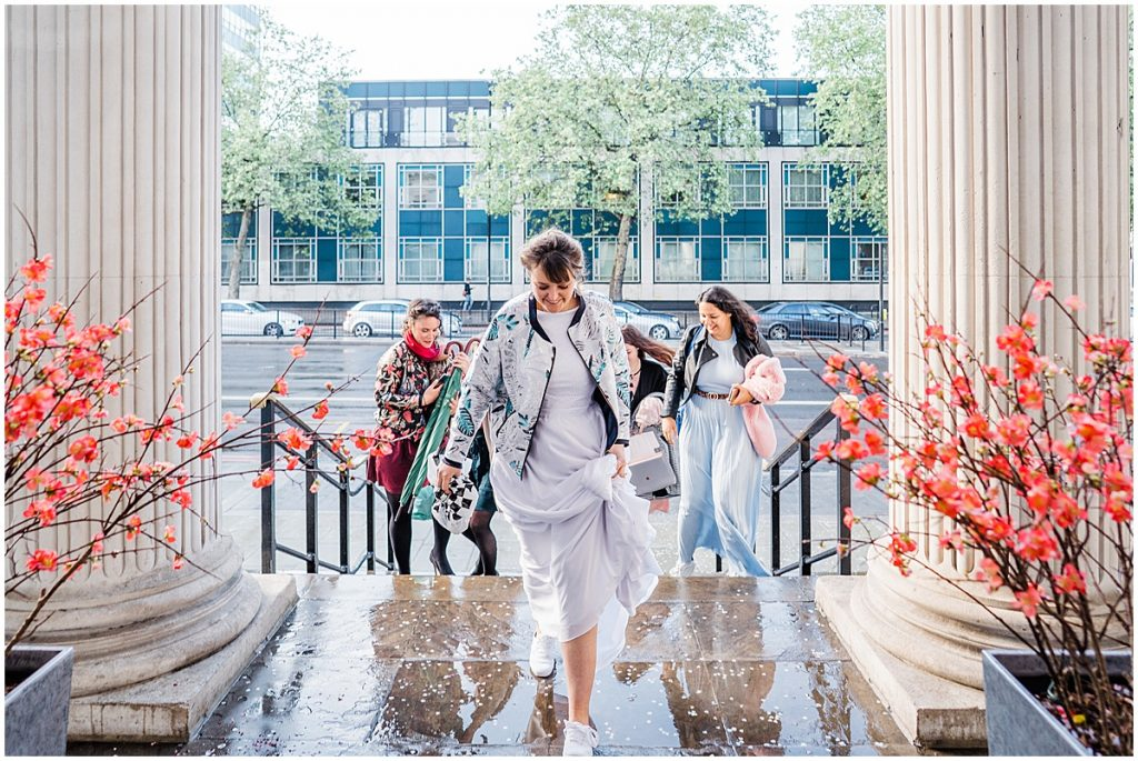 a bride and her bridesmaids walk in to marylebone town hall wedding ceremony.