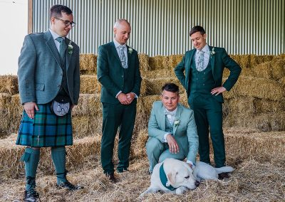 groom and groomsmen with yellow labrador