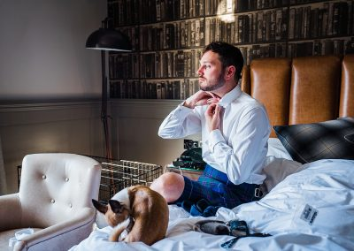 chihuahua grooms while man wearing kilt groom prep dog friendly wedding