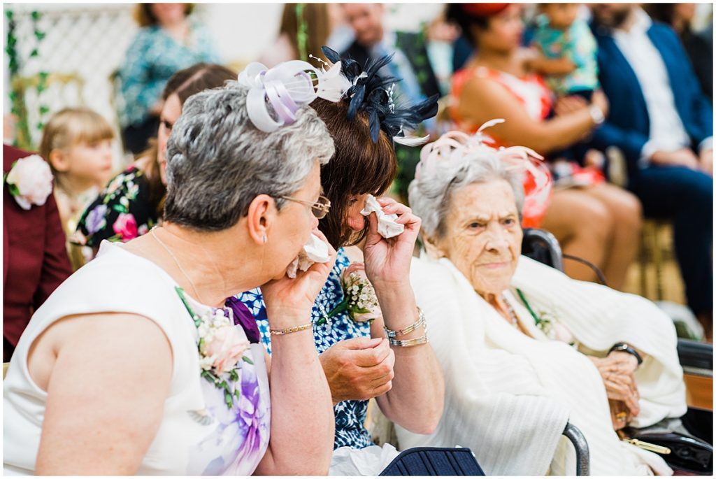 wedding guests wipe away tears at the old library wedding